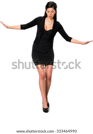 Embarrassed Hispanic young woman with long dark brown hair in casual outfit with arms open - Isolated
