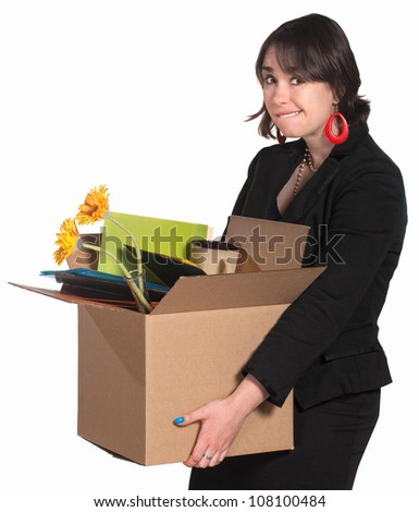 Embarrassed professional woman carrying box of items - stock photo