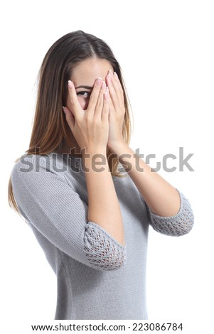 Embarrassed woman looking through her hands covering her face isolated on a white background - stock photo