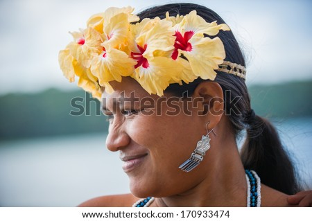 EMBERA VILLAGE, PANAMA, JANUARY 9, 2012: Portrait of an unidentified native Indian woman with flowers in Panama, Jan 9, 2012. Embera village is the Indian reservation in Panama