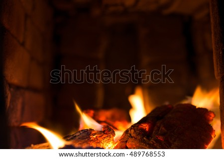 embers with flames in a traditional oven