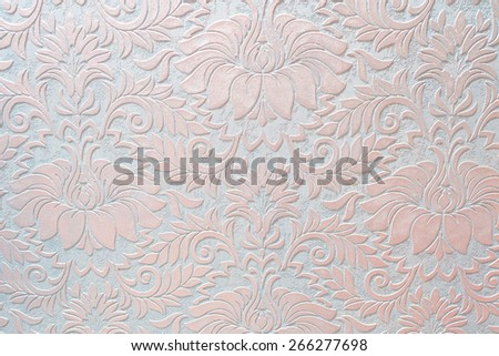 Embossed floral pattern on wallpaper - stock photo