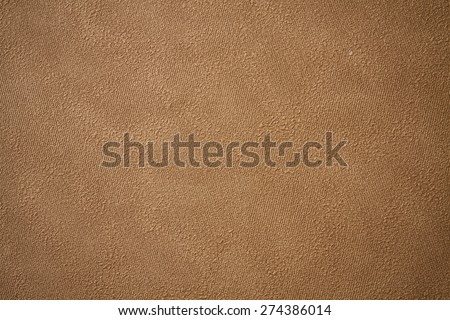 Embossed paper wallpaper in brown tone with vignetting corners - stock photo