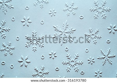 Embossed Snowflake Pattern on Paper,Christmas Decoration. - stock photo