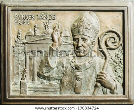 Embossing on doors of Cathedral (or St John basilica of Eger). Cathedral - is only one Classicist building in Eger, second largest church in Hungary, was built in 1831 - 1837. Eger, Hungary. - stock photo