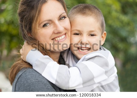 Embrace mother and child - stock photo