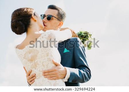 embrace wedding - stock photo
