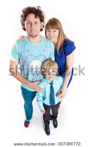 Embracing Caucasian family from three people, parents and son, isolated on white background, full-length - stock photo