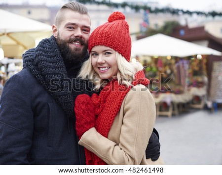 Embracing couple on the market square