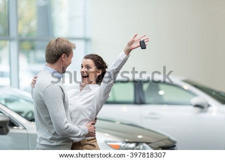 Embracing couple with car keys