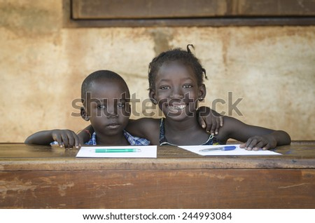 Embracing Education: Couple of African Boy and Girl Smiling School - stock photo