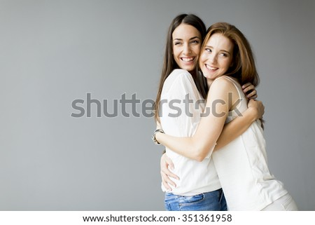 Embracing friends - stock photo