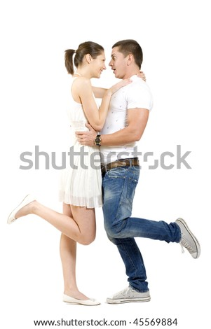 Embracing glamorous couple standing on white background - stock photo