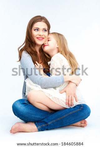 Embracing mother and daughter isolated on white background family portrait. - stock photo
