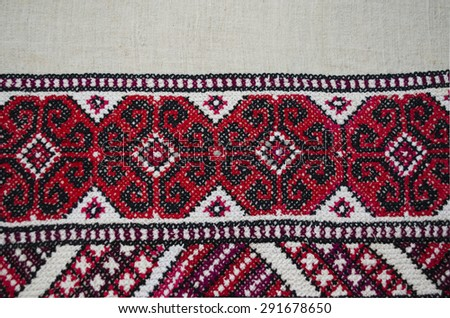 Embroidered cross pattern by border tablecloths on coarse cloth