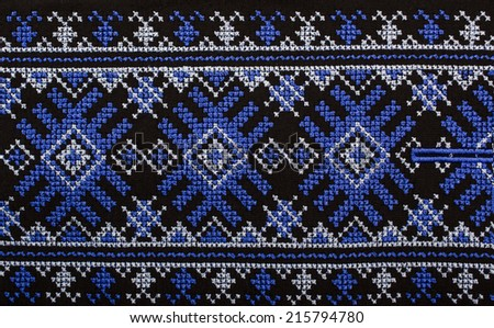 Embroidered cross-stitch pattern, ethnic ornament - stock photo
