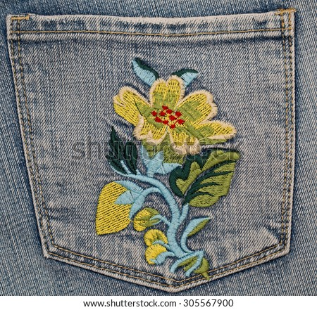 Embroidered Edelweiss flower on denim jeans pocket - stock photo
