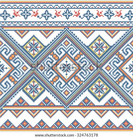 Embroidered handmade cross-stitch ethnic Ukraine pattern - stock photo