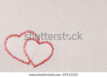 Embroidered symbols on a fabric - stock photo