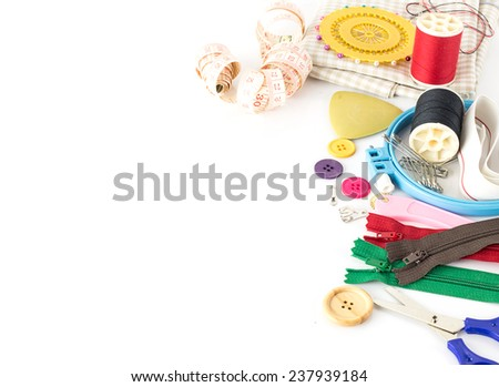 Embroidery tools - sewing item on white background - stock photo
