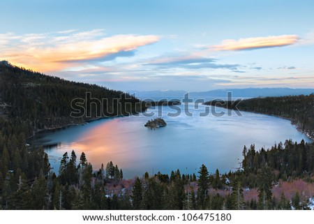 Emerald Bay in Lake Tahoe, California glows with the colors created by the setting sun. - stock photo