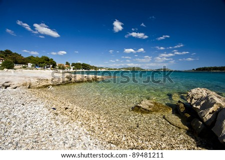 Emerald beach in Pakostane with the islands and the beautiful sea - stock photo