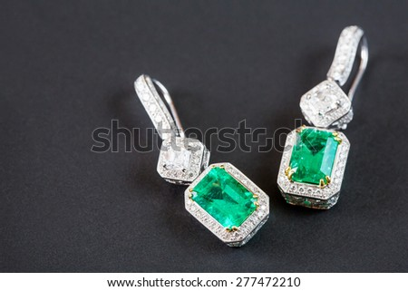 emerald Diamonds Earring in black background - stock photo