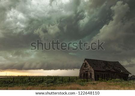 Emerald green storm cloud & barn - stock photo