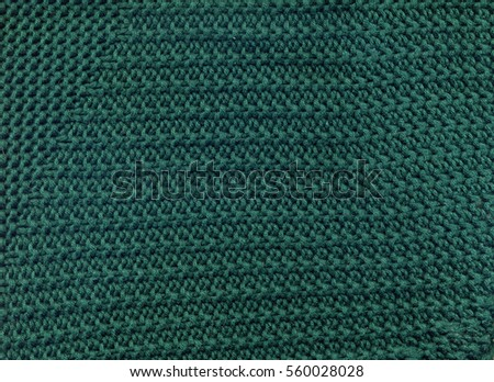Emerald green sweater texture close up