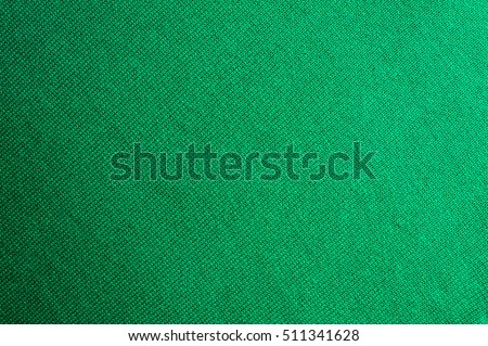 Emerald Knitted Woolen Fabric Texture For Wallpaper And An Abstract Background