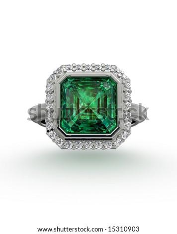 Emerald ring on white - stock photo