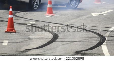 Emergency braking wheel with smoke on the road. - stock photo