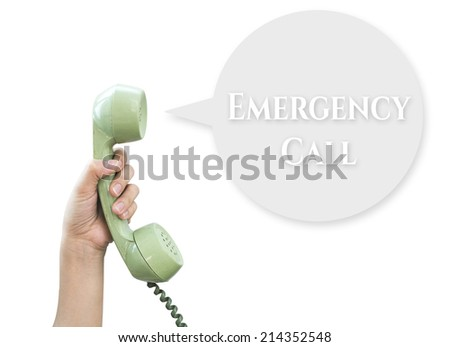 Emergency Call. Hand hold vintage telephone isolated on white background - stock photo