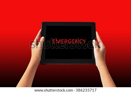 Emergency Concept. emergency words in red color on tabled in hands.