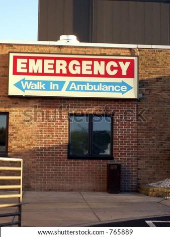 Emergency entrance sign for walkins and ambulances shot in natural light. - stock photo