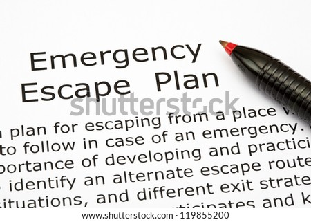 Emergency Escape Plan with red pen - stock photo
