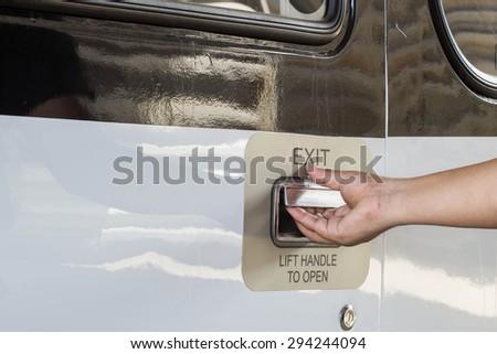 Emergency exit door of aircraft - stock photo