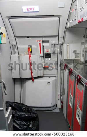 emergency exit door with kitchen in airplane