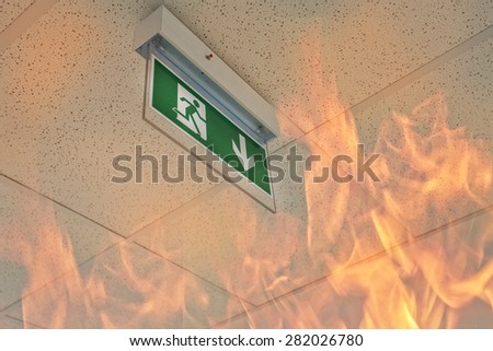 Emergency exit - fire in the office - stock photo