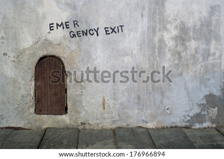 Emergency exit mouse hole with wooden door  - stock photo