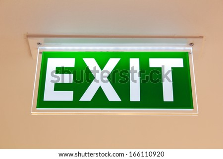 Emergency exit sign. - stock photo