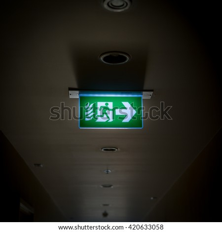 Emergency exit sign for conceptual use of stock market downturn - stock photo