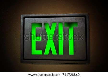 Emergency exit sign. Illuminated office building Exit Sign closeup.