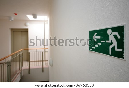 Emergency exit sign in newly built house - stock photo