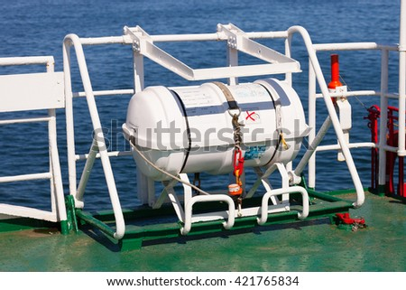 Emergency lifeboat on the side of a ship.  - stock photo