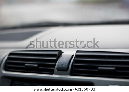 Emergency light button in a car - stock photo