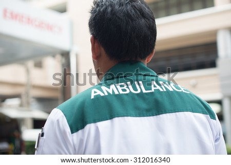 Emergency medical technician uniform backside show ambulance wording  - stock photo