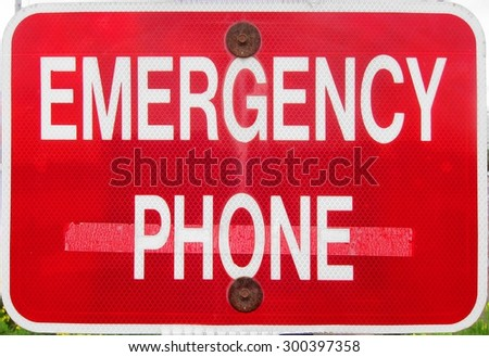 Emergency phone call sign post signpost red and white icon photo photograph - stock photo