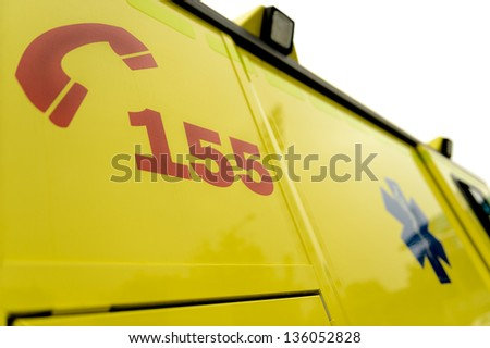 Emergency phone number and paramedic sign on ambulance car - stock photo