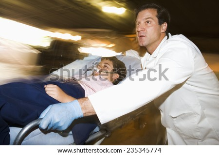 Emergency Physician with Boy - stock photo